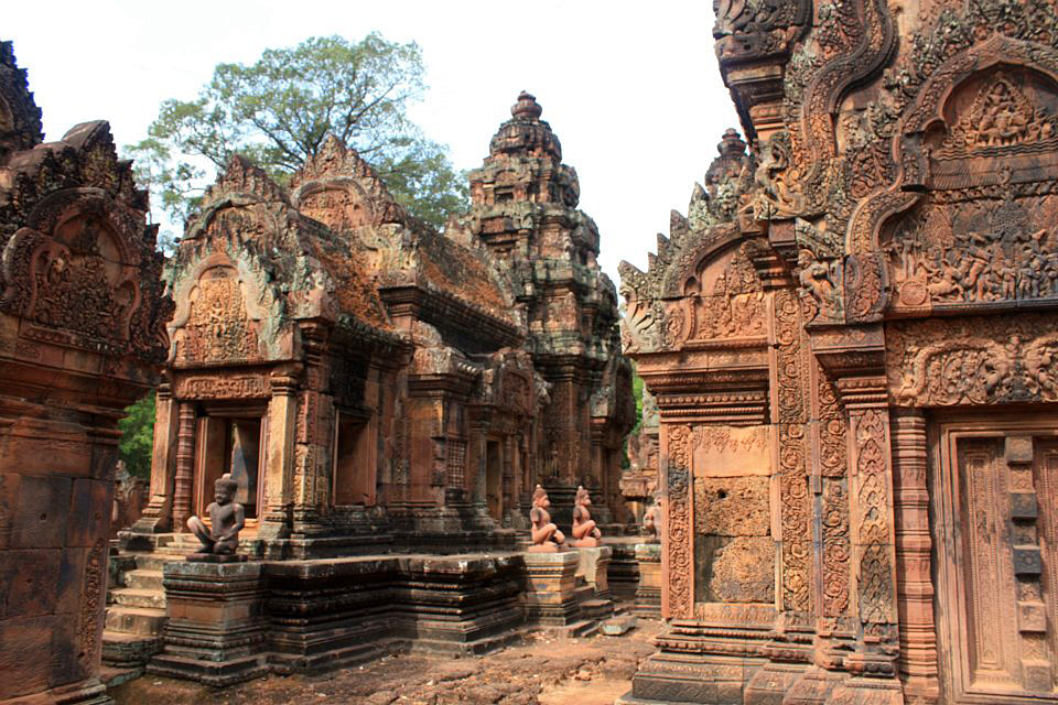 The intricate reliefs carving of red colored sandstone Banteay Srei temple, Siem Reap, Cambodia.